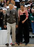 U.S. President Barack Obama and Michelle Obama attend the NCAA Carrier Classic men's college basketball game between Michigan State Spartans and North Carolina Tar Heels in Coronado